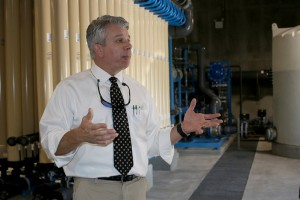 Engineer Greg Davenport of J.R. Wauford & Co. explains increased capacity at Dayton's new Water Treatment Facility.