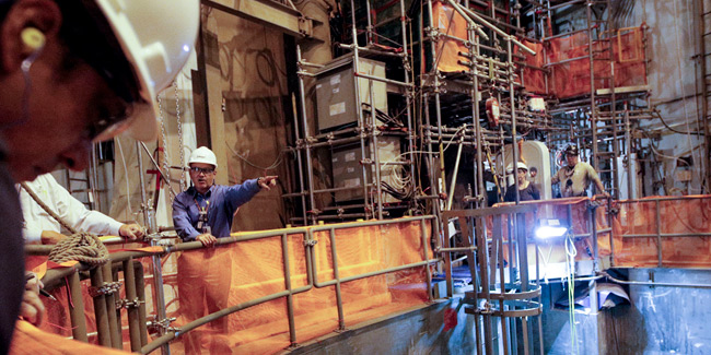 TVA Senior Vice President of Operations and Construction Mike Skaggs inside Watts Bar 2's reactor containment during a tour earlier this year. The plant is expected to begin full commercial operations shortly. [Photo: Doug Strickland/Times Free Press]